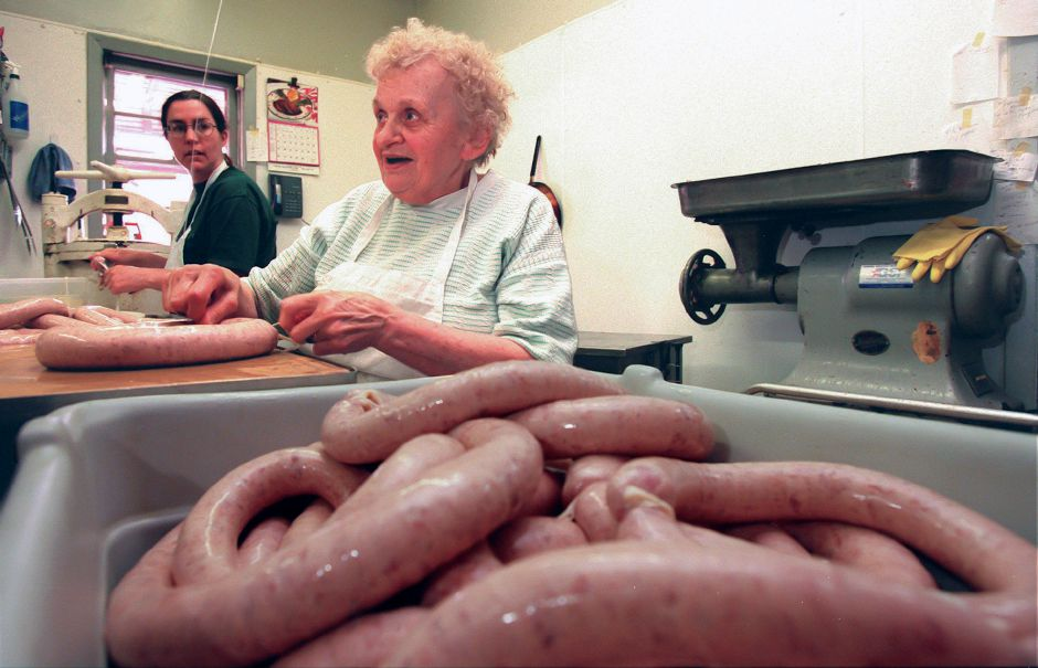 RJ file photo - Val Grodziki, a membver of the Czapiga familes, ties sections of the kielbasa as Judy Czapiga (wife of Ray) stuffs the sausage into pork casings. April 7, 1998.