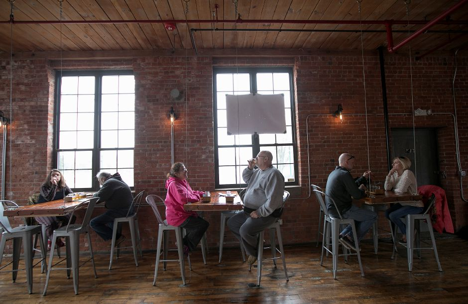 Witchdoctor Brewing Co. ranks ninth on TripAdvisor.com's list of things to do in Southington. In this file photo, patrons sample brews on April 26, 2017. | Dave Zajac, Record-Journal