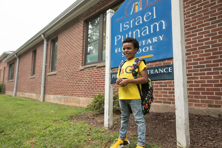 First-grade student Courtney Miller, 5, poses for pics before the first day of school at Israel Putnam Elementary School in Meriden, Wed., Aug. 28, 2019. Dave Zajac, Record-Journal