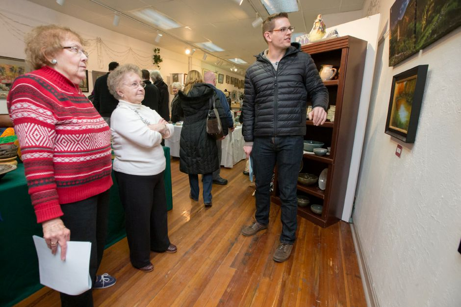 Samuel Martin of Stratford right talks about his images he created in Italy with Betty McGrath of Meriden left and Rose Marie Sticking of Meriden Saturday during Gallery 53