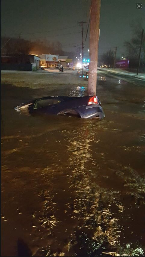 A section of Middletown Avenue flooded early Thursday after a car struck a fire hydrant.