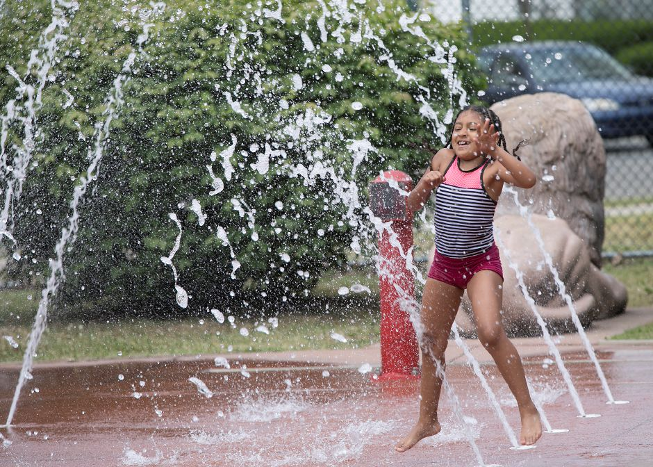 Xilette Rose, 7, of Meriden, cools down on the splash pad at the City of Meriden Lions Club Water Park in Meriden, Wednesday, June 20, 2018. The water park opened for the summer last Friday. Dave Zajac, Record-Journal
