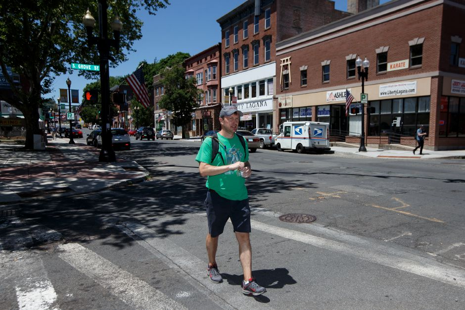 "Senator Chris Murphy (D) crosses South Grove Street in Meriden to the Senior Citizens Center Saturday during the Senators ""WALK ACROSS CONNECTICUT"" for Town Hall meetings in Meriden July 7, 2018 