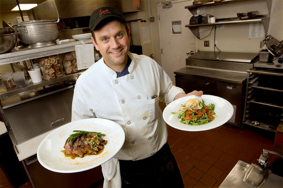 Chef, Nick Maggioni, shows a steak tagliata dish, left, and arugula frisee salad with blueberries, candy pecans, roasted peppers and softshell crab, right, at Geno