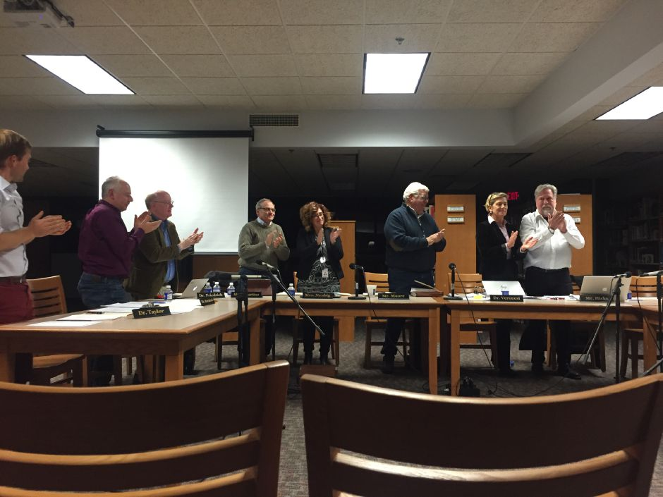 The Regional School District 13 Board of Education claps for member Nancy Boyle, who stepped down at Nov. 14