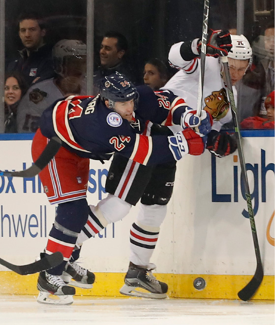 New York Rangers center Oscar Lindberg (24) collides with Chicago Blackhawks center Dennis Rasmussen (70) during the first period of an NHL hockey game Tuesday, Dec. 13, 2016, in New York. (AP Photo/Julie Jacobson)