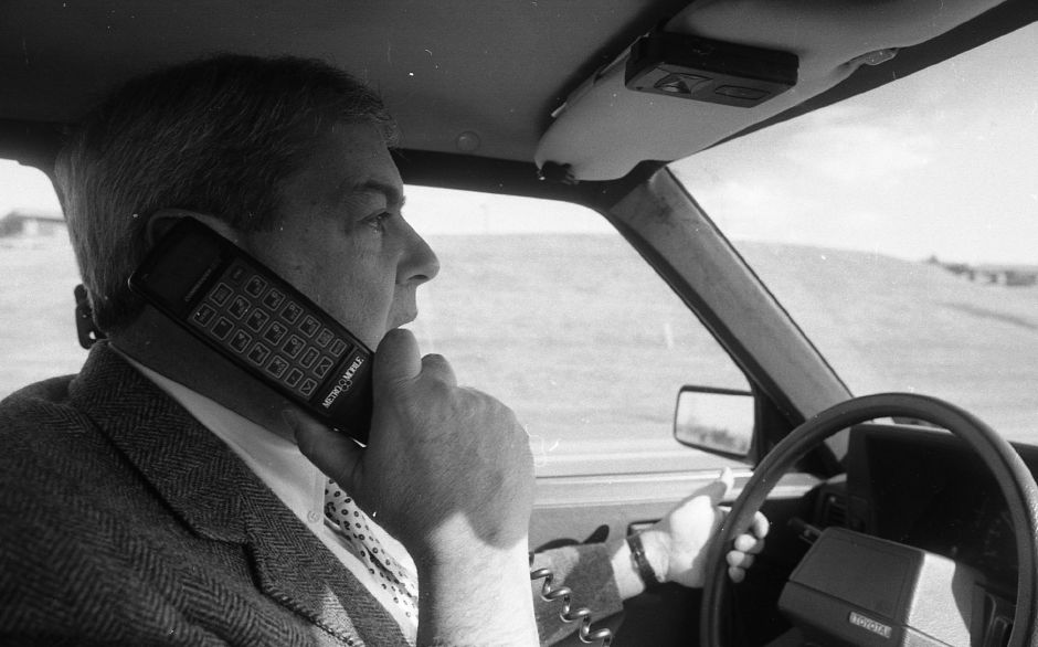 RJ file photo - Walter Pacheco, president of Phone Country Inc., says he had to be convinced about the quality and performance of car telephones, but now is sold on the latest in automotive accessories, March 1989.