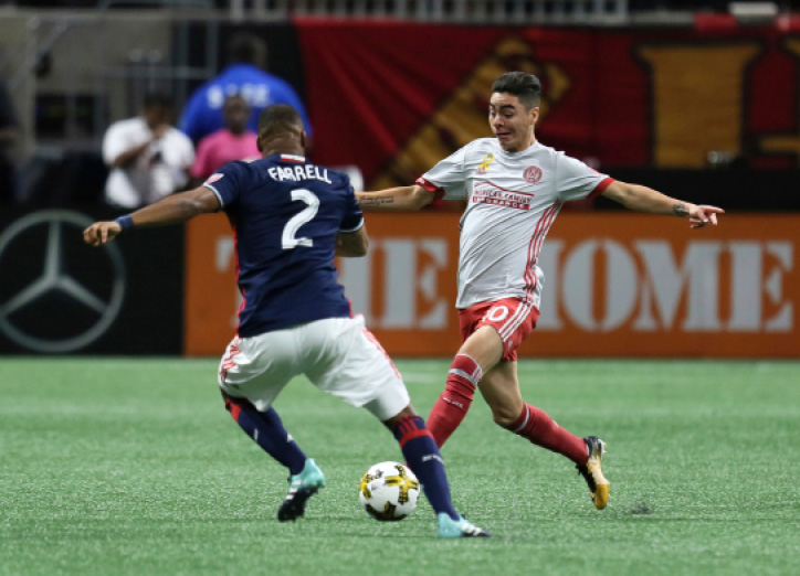 Atlanta United midfieldeer Miguel Almiron works with the ball as New England Revolution