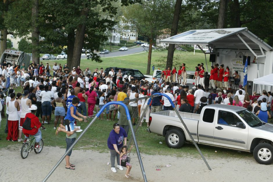 A large crowd gathers around the stage to watch the Meriden dance group 2 Hot 2 Handle do their routine at City Park during the National Night Out event on August 1, 2006.