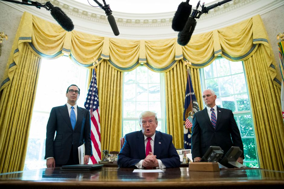 President Donald Trump speaks before signing an executive order to increase sanctions on Iran, in the Oval Office of the White House, Monday, June 24, 2019, in Washington. Trump is accompanied by Treasury Secretary Steve Mnuchin, left, and Vice President Mike Pence. (AP Photo/Alex Brandon)