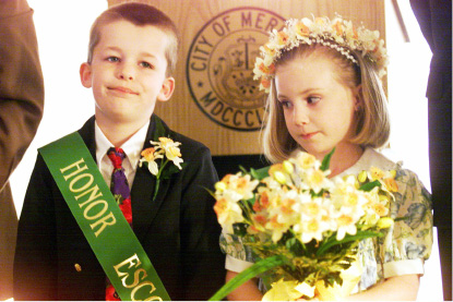 Honor Escort Jacob Tracy looks thrilled as Little Miss Daffodil Sara Richards shyly accepts the honors of being chosen Wed., April 21, 1999.
