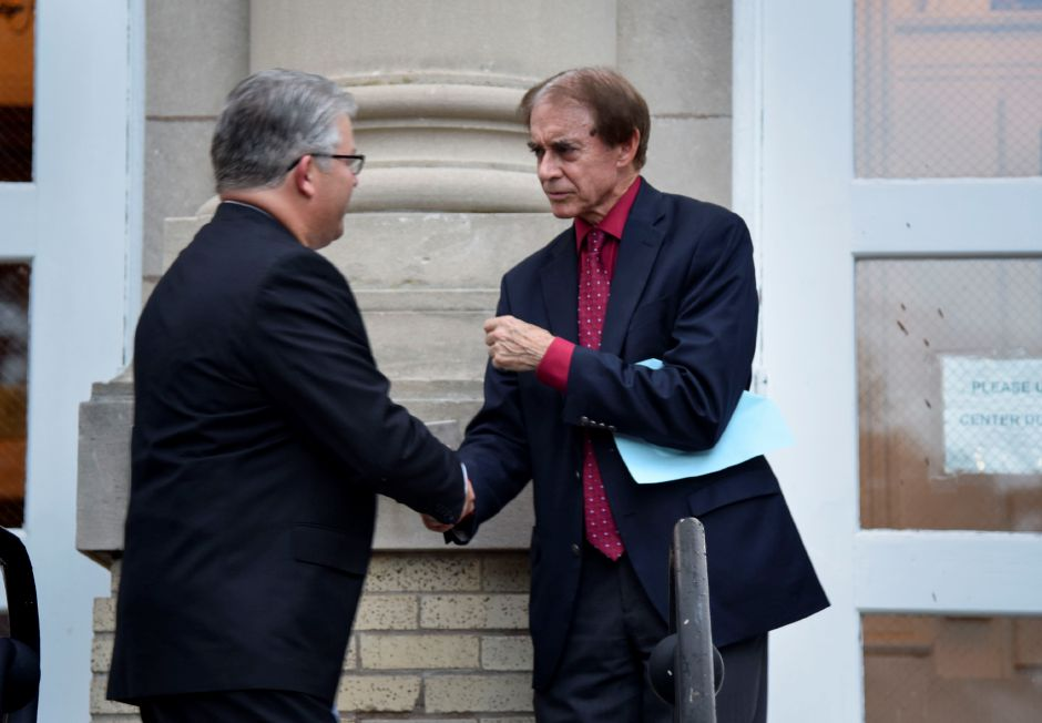 Mayor William W. Dickinson, Jr. shakes hands with Robert Blanchard, this year