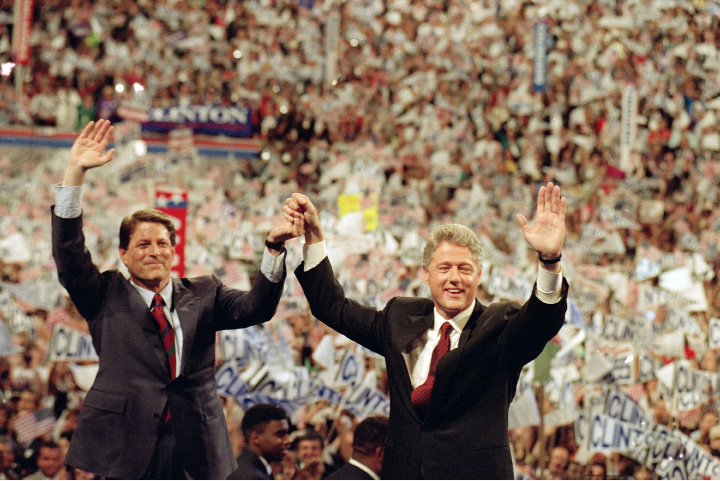 Democratic presidential nominee Bill Clinton, right, and his running mate Al Gore, raise their arms at the end of the Democratic National Convention in New York, July 16, 1992.  (AP Photo/Marcy Nighswander)