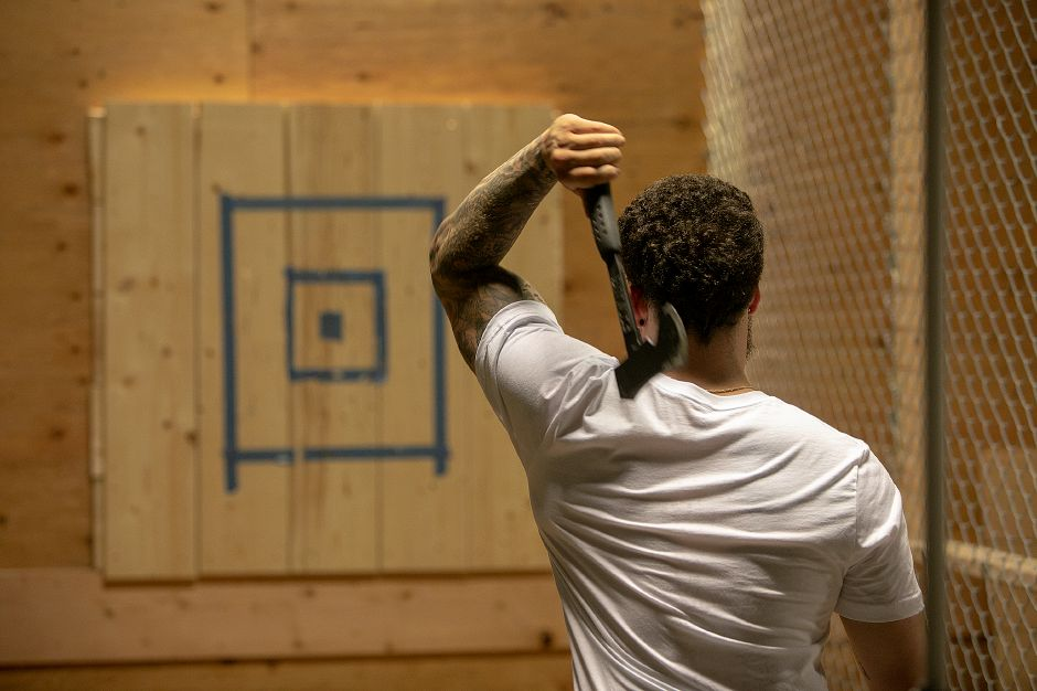 Jerry Ferraro, of Wallingford, co-owner of Blue Ox Axe Throwing, takes aim with an ax at the new business at 21 N. Plains Industrial Rd. in Wallingford, Friday, July 20, 2018. The business opens in August. A separate ax throwing business has requested a special permit to located in North Haven. Dave Zajac, Record-Journal