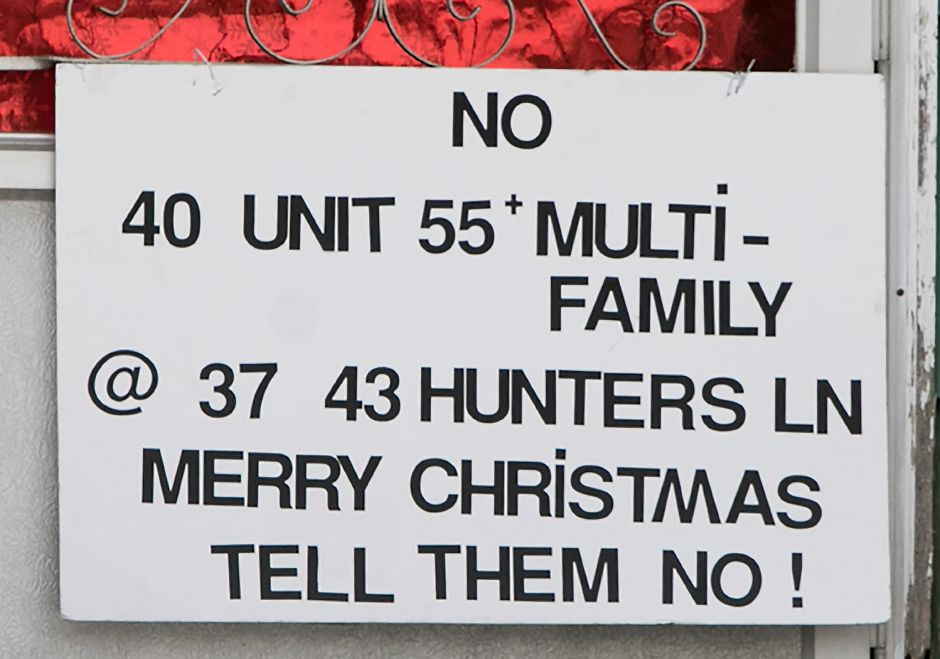 A sign posted on the front door of a Wonx Spring Road resident against a proposed development off Hunters Lane in Southington, Monday, Dec. 18, 2017. Dave Zajac, Record-Journal