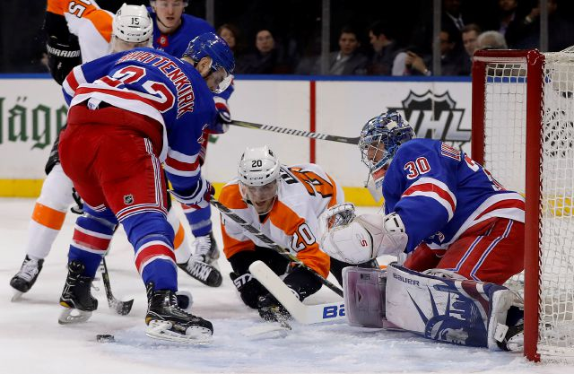 New York Rangers defenseman Kevin Shattenkirk (22) and Philadelphia Flyers left wing Taylor Leier (20) look for the rebound as New York Rangers goaltender Henrik Lundqvist (30) defends the goal during the first period of an NHL hockey game, Tuesday, Jan. 16, 2018, in New York. (AP Photo/Julie Jacobson)