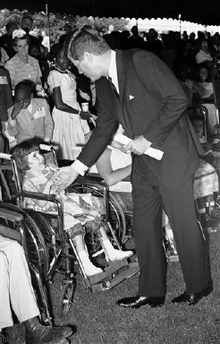 President John Kennedy greets Susan Noel during a party on the White House lawn in Washington on August 22, 1961 for disabled children of the Washington area. (AP Photo)