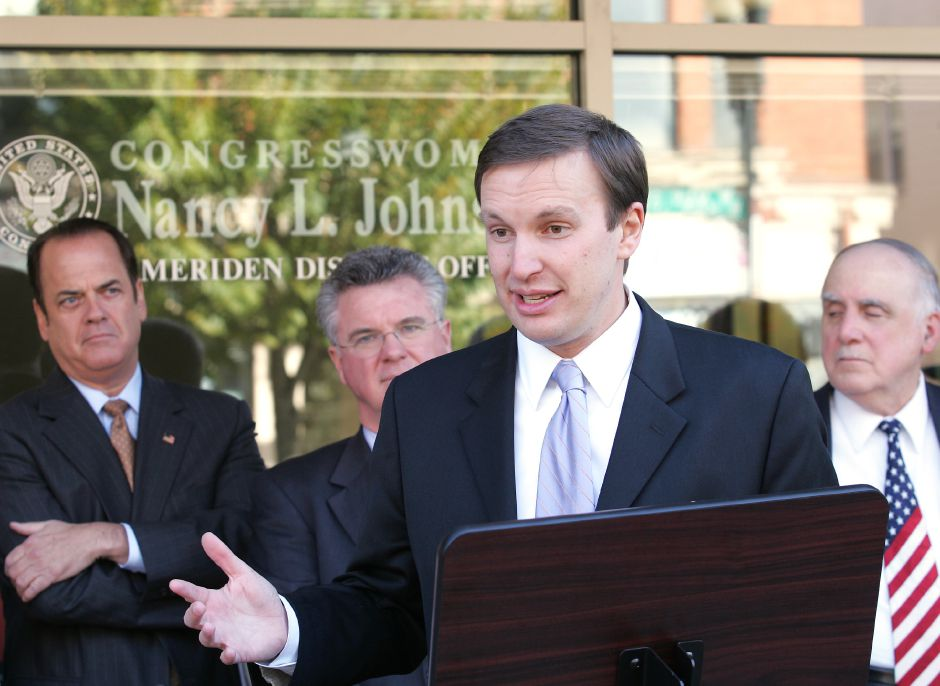 Democratic candidate for the 5th district Chris Murphy, center, speaks during a press conference in front of the Meriden Senior Center in Meriden, Conn. Friday afternoon October 27, 2006. Congresswoman Nancy Johnson has an office at the senior center. The office was opened by Congressman Jim Maloney years ago. Behind on the left is State Sen. Thomas Gaffey, Rep. Christopher Donovan, middle, and Deputy Mayor Matthew Dominello. Chris Angileri/Record-Journal.