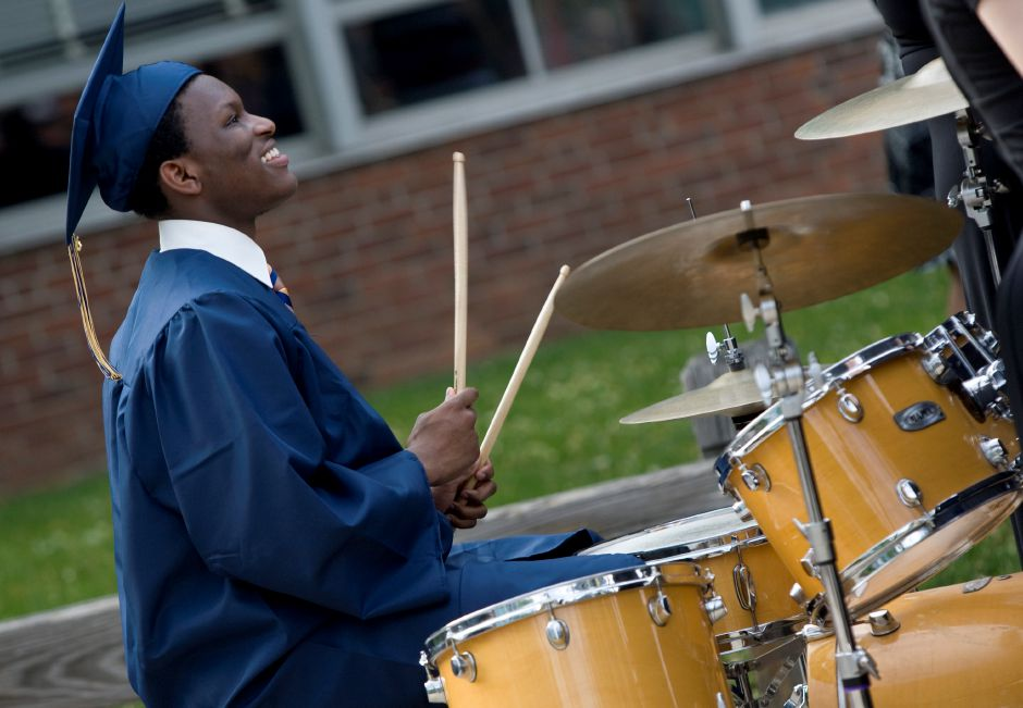 Graduate Malik Robie drums as part of a musical selection during graduation ceremonies at Platt High School in Meriden, Friday, June 19, 2015. | Dave Zajac / Record-Journal