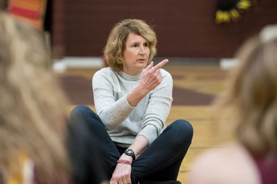 Sheehan Titan alumna Cathy Inglese calls on the Titans girls basketball team  to introduce themselves on Thursday  during practice at Sheehan High School in Wallingford. Inglese  spoke to the girls  about winning the state championship in 1976.