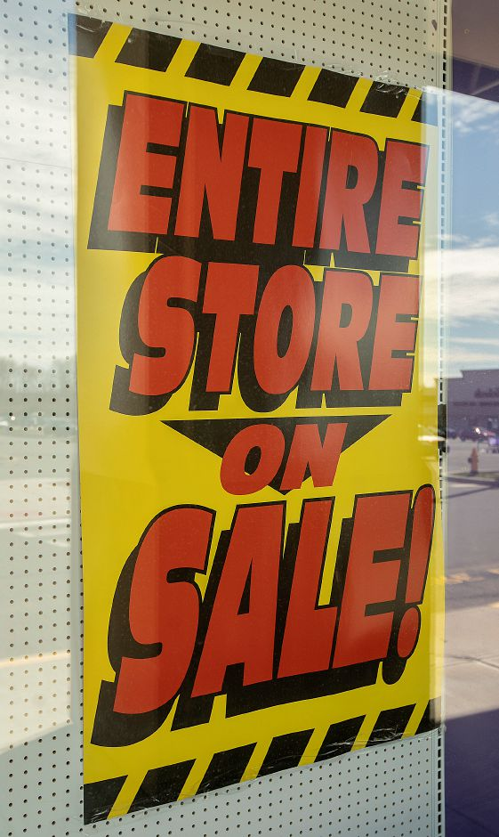 Sale posters at Party City in the Townline Square in Meriden, Thurs., Apr. 11, 2019. Dave Zajac, Record-Journal