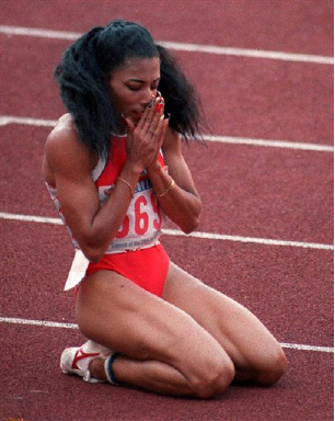 Florence Griffith Joyner falls to her knees in a prayerful manner after taking then 200-meter Olympic final in world record time in Seoul, in this Sept. 29, 1988 photo. Joyner died Monday Sept. 21, 1998 in Mission Viejo, Calif.,  of an apparent heart seizure. She was 38. (AP photo/Rusty Kennedy)