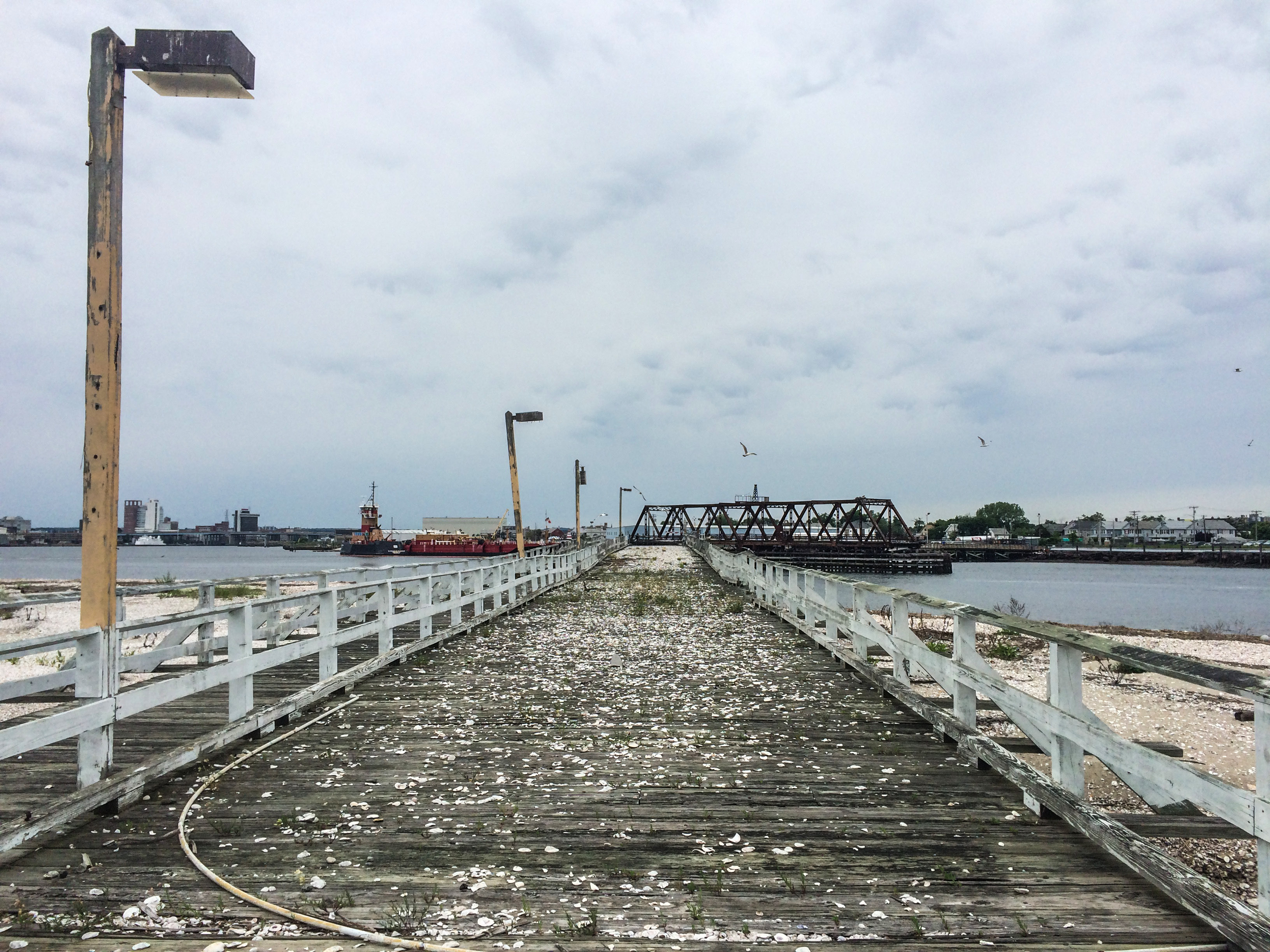 The old bridge connecting Pleasure Island to Bridgeport, which was destroyed in a fire. The bridge is now fenced off and beachgoers can use a free water taxi to get to Pleasure Island. | Richie Rathsack/Record-Journal