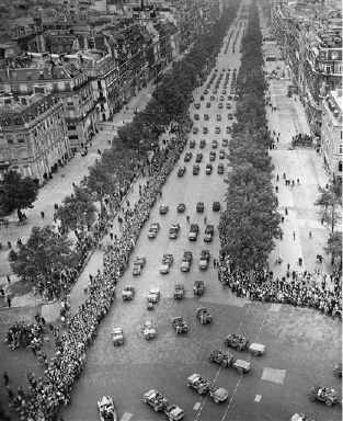 Parisian line the Champs Elysees to cheer the American Troops on Parade towards the Arc De Triomphe on  Aug. 29, 1944. (AP Photo)