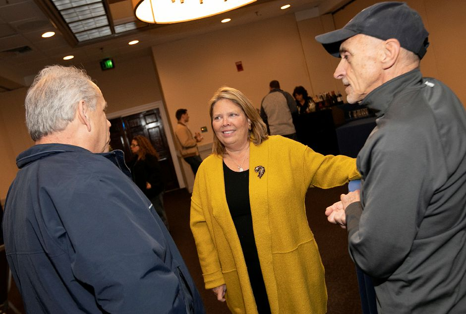 13th Senate District candidate Mary Daughtry Abrams (D) talks with supporters Sal Scarpati, left, and John Battista while waiting for results in the 2018 midterm elections in Meriden, Tues., Nov. 6, 2018. Dave Zajac, Record-Journal