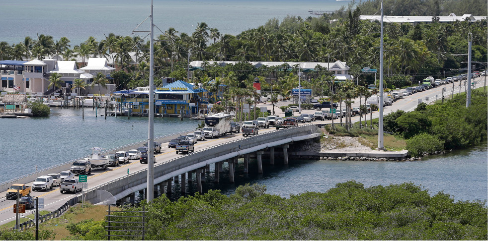 Motorists head north of Tavernier, Fla., on US 1, in anticipation of Hurricane Irma, Wednesday, Sept. 6, 2017.  Keys officials announced a mandatory evacuation Wednesday for visitors, with residents being told to leave the next day. (AP Photo/Alan Diaz)