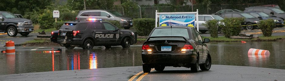 A motorist retreats flood waters at the intersection of Pratt and Mill Streets in Meriden, Tuesday, Sept. 25, 2018. Heavy rain Tuesday evening closed roads and flooded basements of local homes. Dave Zajac, Record-Journal