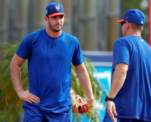 New York Mets pitcher Matt Harvey, left, talks with pitching coach Dave Eiland during spring training baseball practice Tuesday, Feb. 13, 2018, in Port St. Lucie, Fla. (AP Photo/Jeff Roberson)