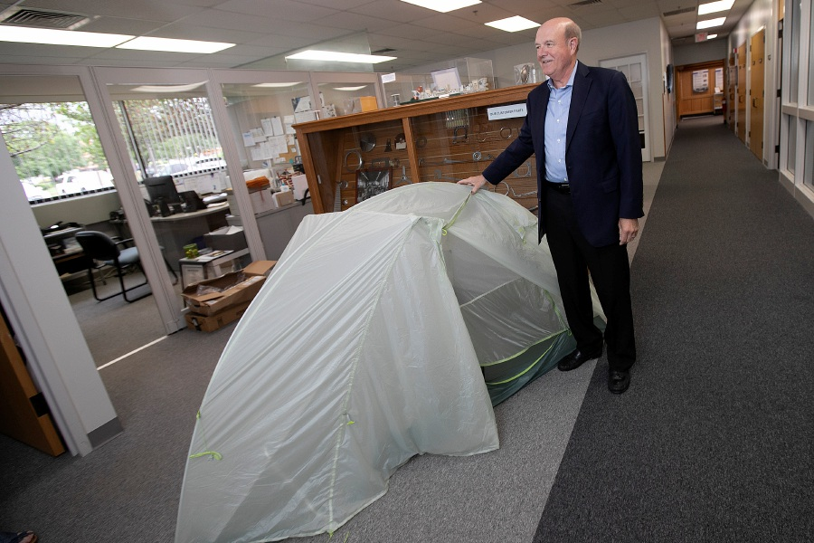 Ulbrich Chairman and CEO Chris Ulbrich shows the tent he