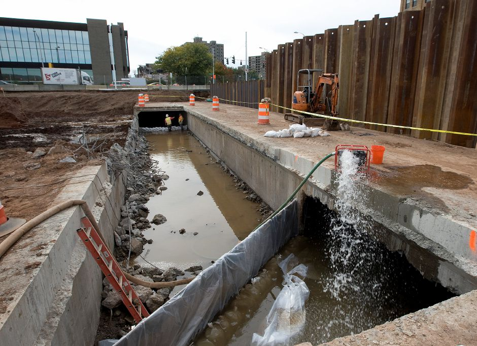One of two underground culverts exposed in the southwest corner of the Hub site, Friday, October 10, 2014. Water is being diverted to the second culvert, right, in order for work to continue on the exposed culvert, left,. | Dave Zajac / Record-Journal