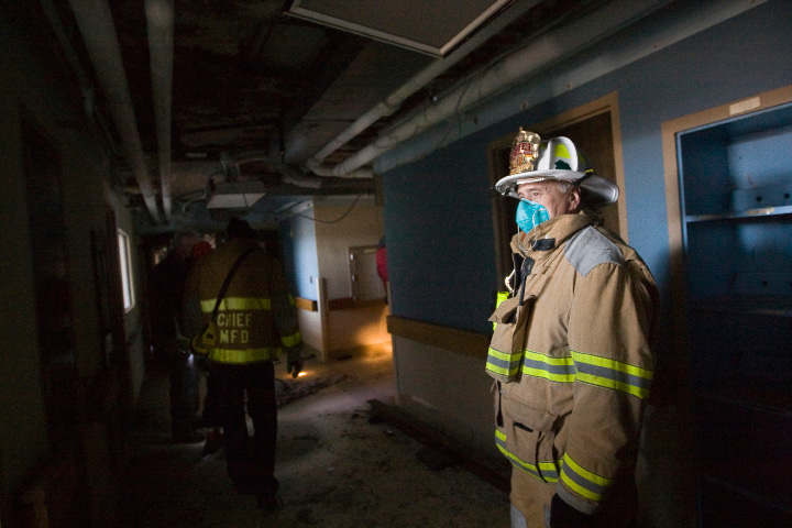 Meriden Fire Chief Ken Morgan wears a protective mask while touring the seventh floor of the former Meriden-Wallingford hospital on Cook Ave. in Meriden, Thursday, January 9, 2014.   |  Dave Zajac / Record-Journal