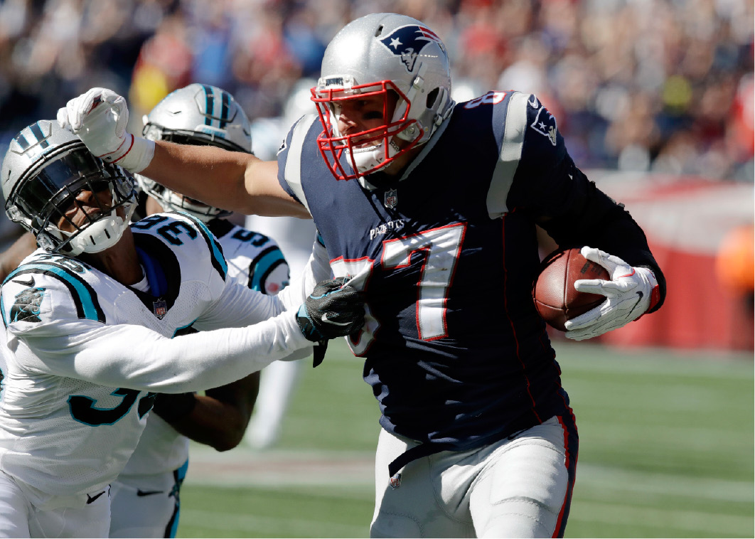 0669e7940 New England Patriots tight end Rob Gronkowski (87) tries to shove away Carolina  Panthers
