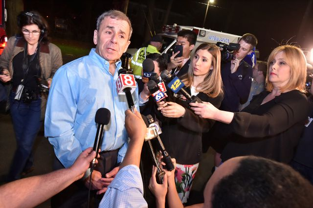 North Haven First Selectman Michael Freda speaks to the media hours after emergency personnel responded at the scene of and explosion and reported stand-off Wednesday, May 2, 2018 in North Haven, Conn. (Catherine Avalone/New Haven Register via AP)