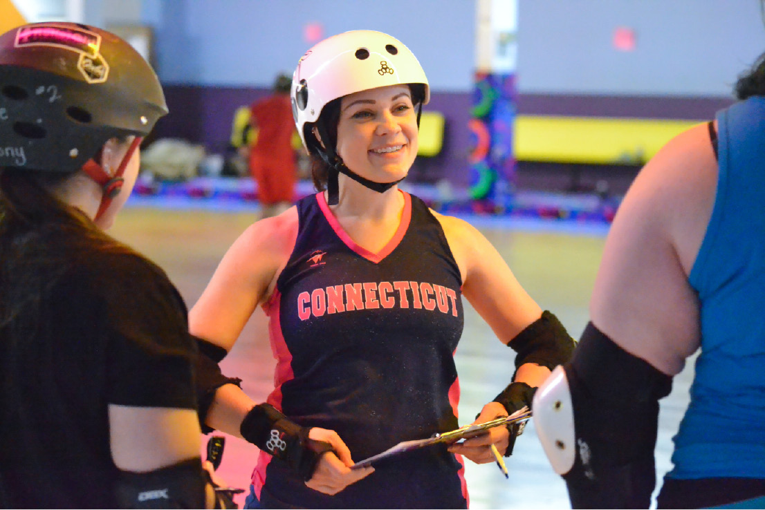 Michele Peruzzi, of Meriden, gives instructions during CT Rollergirls tryouts on Thursday, Feb. 2, 2017. Peruzzi is a team captain and coach. | Pete Paguaga. Record-Journal