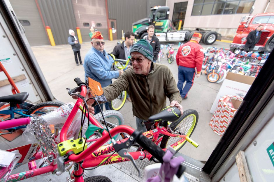 Bikes are loaded into trucks after Manafort Brothers Inc., of Plainville, donated 100 bikes to the Marine Reserves Toys for Tots program on Dec. 12.Devin Leith-Yessian, Record-Journal