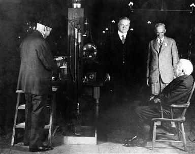 From left to right are: Francis Jehl, President Herbert Hoover, Henry Ford and Thomas Edison, at the 50th anniversary of the incandescent light at Greenfield Village, Michigan, Oct. 21, 1929. Edison is showing the president how he made the first lamp. (AP Photo)