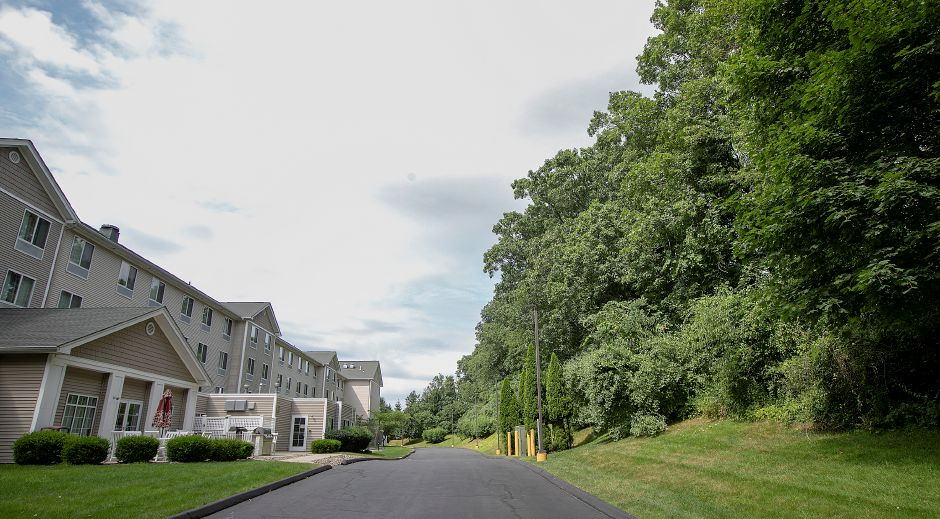 Homewood Suites, left, on Miles Drive off Route 68 in Wallingford, Mon., July 22, 2019. The Inland Wetlands and Watercourses Commission granted a wetlands permit last week for a new hotel in the wooded area seen at right. Dave Zajac, Record-Journal