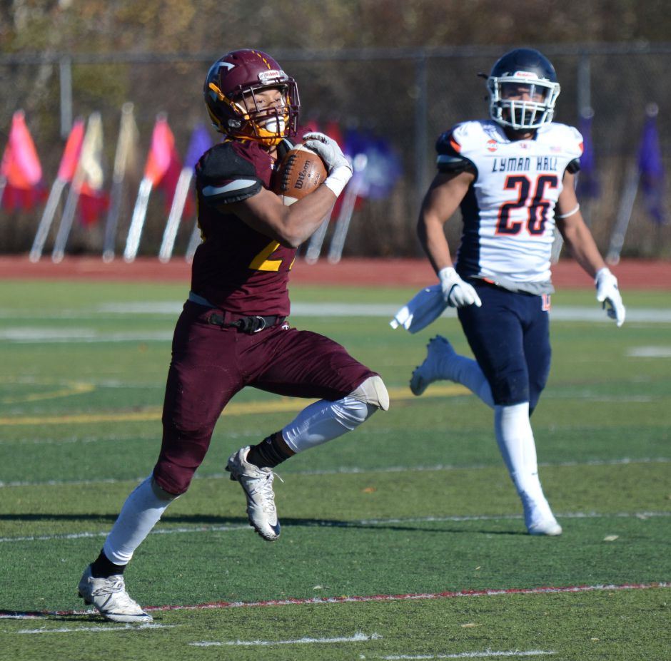 Jordan Davis, of Sheehan, runs in the team's annual Thanksgiving Day football game against Lyman Hall on Thursday, Nov. 23, 2017. The Titans defeated the Trojans, 49-20. | Bryan Lipiner, Record-Journal