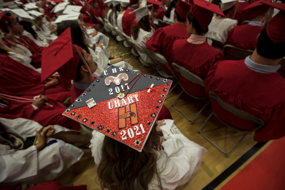 Graduate Hallie Granoth dons her decorative cap before the start of graduation ceremonies at Cheshire High School, Wednesday, June 14, 2017. Granoth will go on to study biology at the University of Hartford. | Dave Zajac, Record-Journal