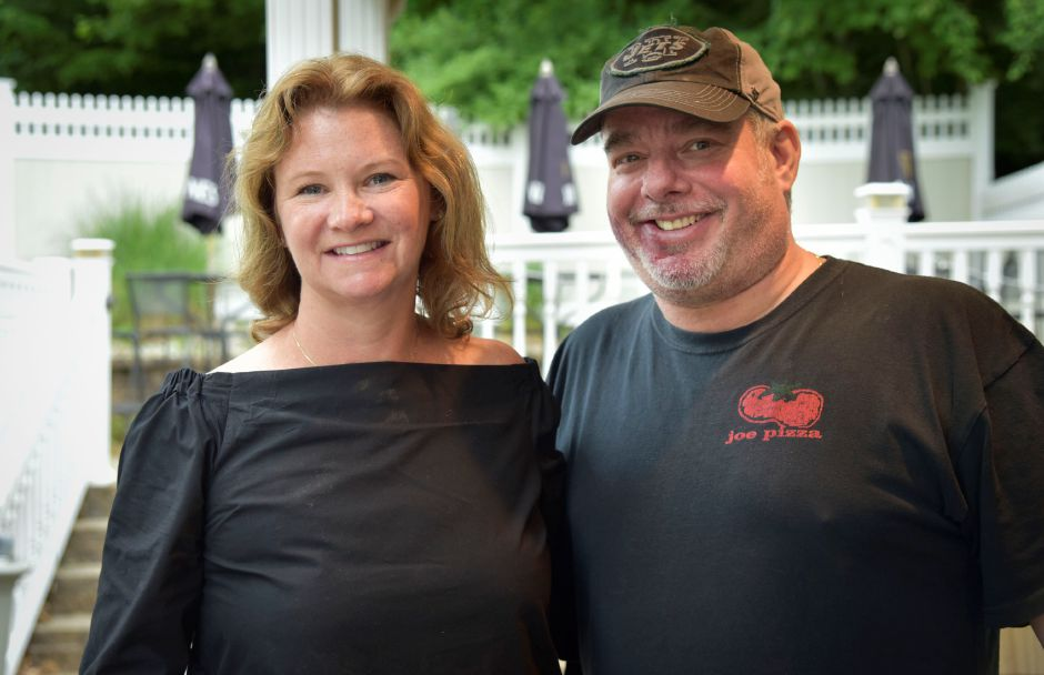 Co-owners Tara Satrazemis and Chris Giotsas pose Tuesday at 100 New Haven Road, Durham, the former Time Out Taverne. They have renamed the restaurant Horseshoe Taverne and plan to open in September.  Bailey Wright, Record-Journal