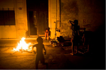 People gather near a fire while electricity is out and their homes are wet from flooding after the passage of Hurricane Irma in Havana, Cuba, Sunday, Sept. 10, 2017. There were no immediate reports of fatalities in Cuba, where the government prides itself on disaster preparedness and said it had evacuated more than 1 million people. (AP Photo/Ramon Espinosa)