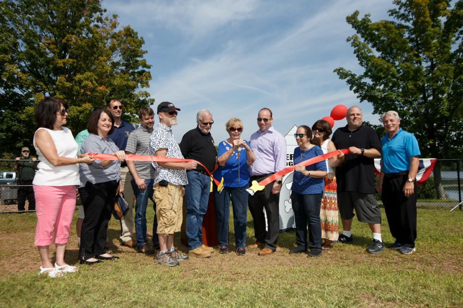Jim Moran left Edna Roberts and Mayor Kevin Scarpati officially open the park Saturday during the opening of the Meriden Dog park in Meriden August 25, 2018 | Justin Weekes / Special to the Record-Journal