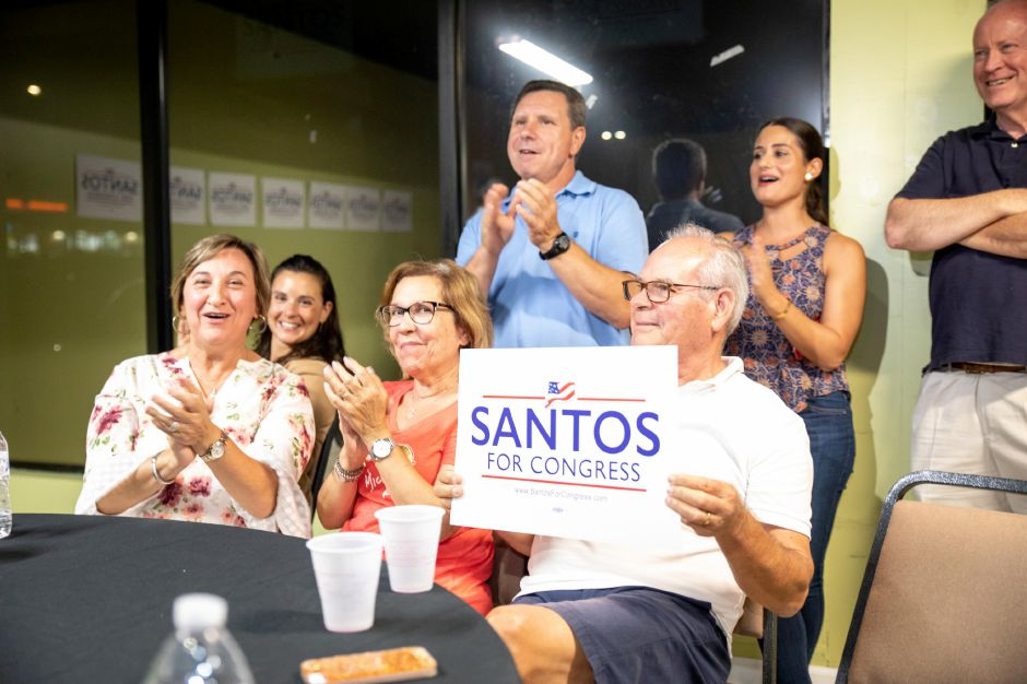 Supporters of Republican Manny Santos applaud after he declared victory in the Republican primary for District 5 on August 14, 2018. | Devin Leith-Yessian/Record-Journal