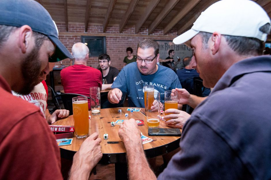 Kinsmen Brewing ranks fifth on TripAdvisor.com's list of things to do in Southington. In this file photo, Tim Sena plays Brew Dice, a card game created by local game creator Andy Geremia on August 10, 2017. | Devin Leith-Yessian/Special to the Record-Journal