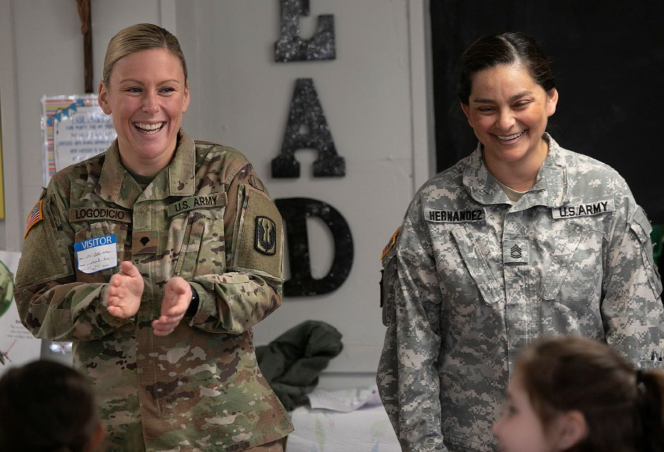 U.S. Army Specialist Nicole Logodicio, of Meriden, left, and Sgt. First Class Laura Hernandez, of Meriden, visit with first-grade students at Our Lady of Mount Carmel school in Meriden, Monday, Nov 12, 2018. Dave Zajac, Record-Journal