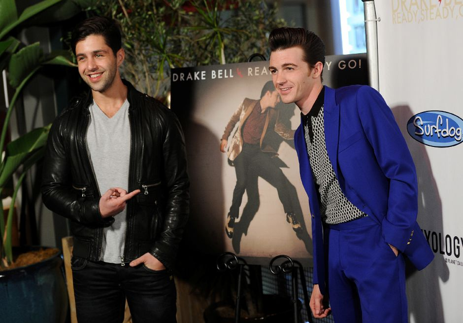 Drake Bell, right, poses with actor Josh Peck poses at a release party for Bell